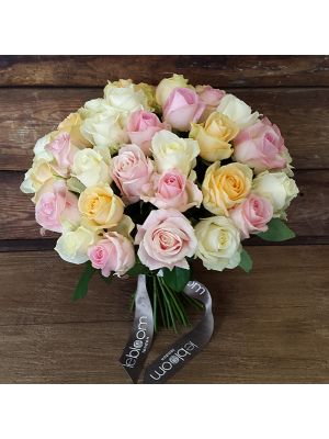 bouquet of white, peach and pink roses