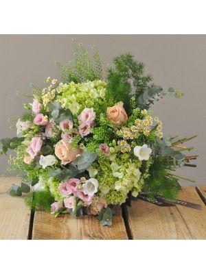 bouquet of green hydrangeas, peach roses, pink lisianthus