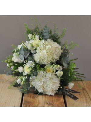 bouquet of white hydrangeas, white roses and white lisianthus